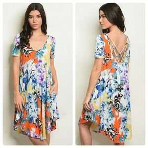 Pretty summer dress with tropical colored flowers
